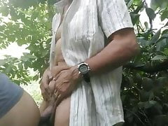 Old man eating the young man's ass in the middle of the bush