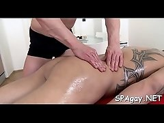 Sexy white hunk is enjoying a lusty massage from dark stud